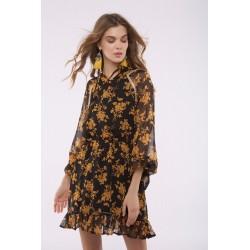 Vestido con volante bajo y estampado floral en tono mostaza