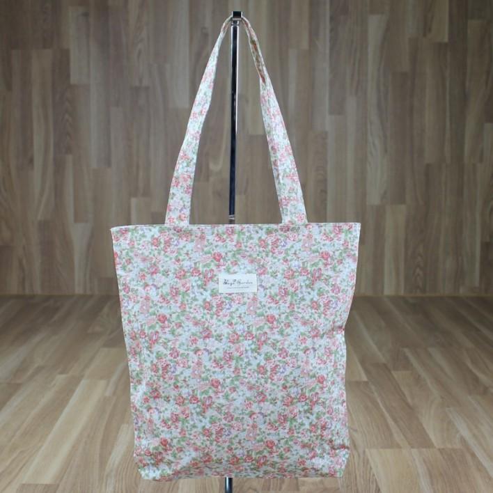 Bolsa estampado flores fondo rosa palo